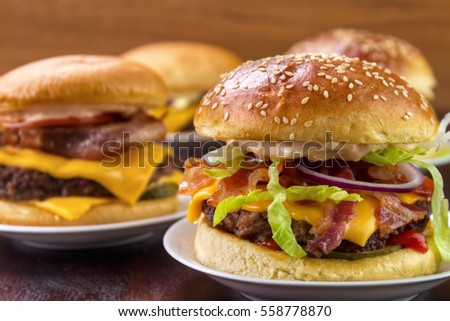 Group of different burgers on dish closeup