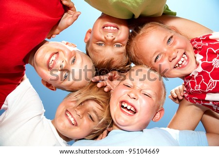 Group of different children having good summertime - stock photo