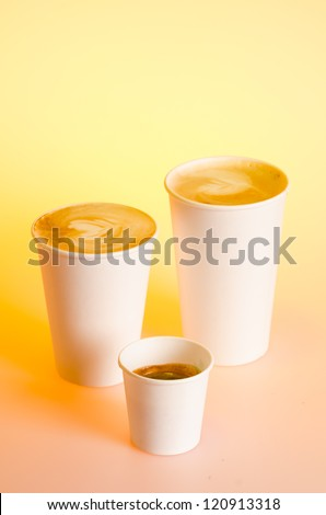 Group of different coffee drinks sizes in cardboard cups - stock photo