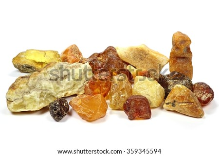 Group of different colored north sea amber stones isolated on white background