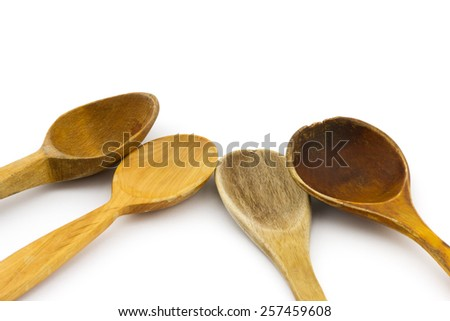 Group of different old used wooden spoon isolated on white background  - stock photo