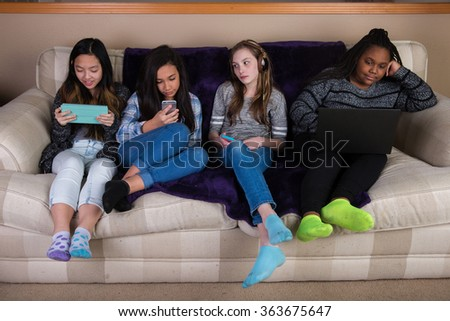Group of disengaged, bored children on mobile devices