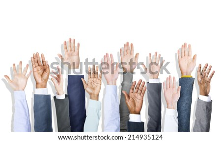 Group of Diverse Business People's Hands Raised - stock photo