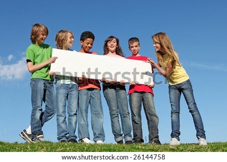 group of diverse kids holding blank sign