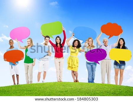 Group of Diverse Multi-Ethnic People Outdoors Holding Colorful Speech Bubbles