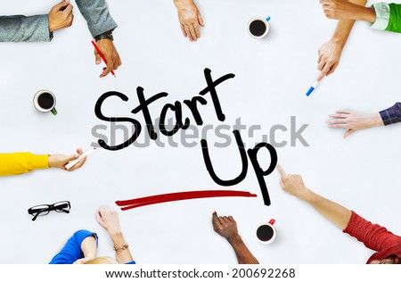 "Group of Diverse People Brainstorming About ""Startup"" - stock photo"