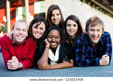 Group of diverse students outside in a pyramid - stock photo
