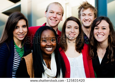 Group of Diverse students outside smiling - stock photo