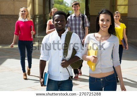Group of diverse students outside smiling together - stock photo