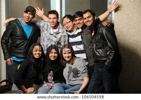 Group of diverse students smiling indoors - stock photo