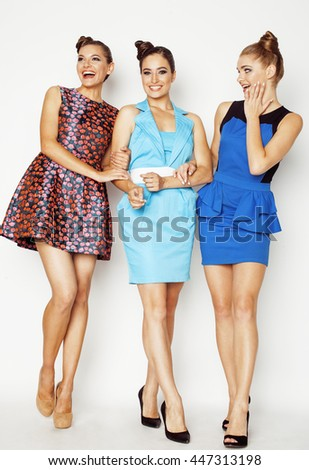 group of diverse stylish ladies in bright dresses isolated on white smiling having fun