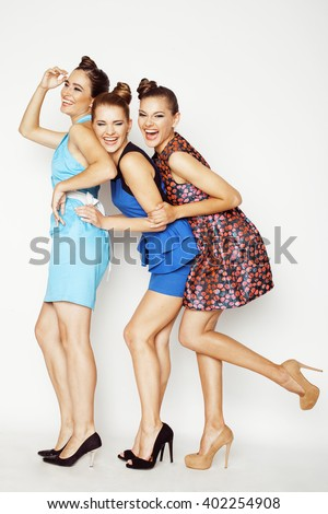 group of diverse stylish ladies in bright dresses isolated on white smiling having fun, watching selfie