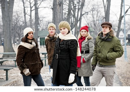 Group of diverse young people outdoors in winter park - stock photo