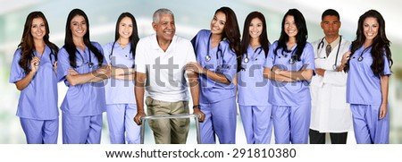 Group of doctors and nurses set in a hospital with a patient - stock photo