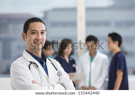 Group of doctors and nurses standing in a hospital. Multi-ethnic team of medical staff.