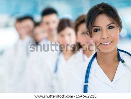 Group of doctors at the hospital smiling  - stock photo
