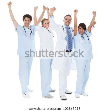 Group of doctors celebrating success. Isolated on white - stock photo