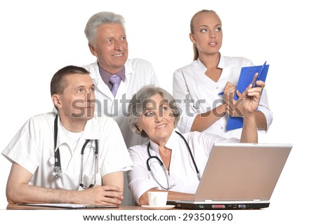 Group of doctors discussing at the table - stock photo