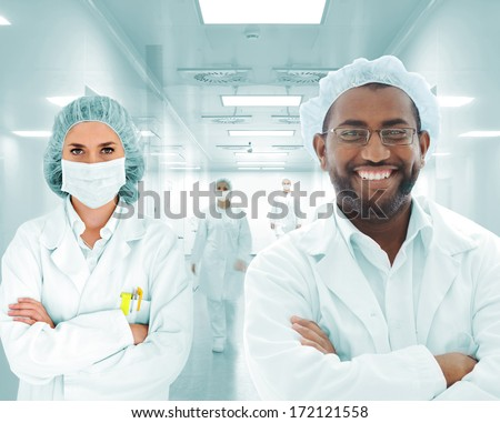 Group of doctors in hospital - stock photo