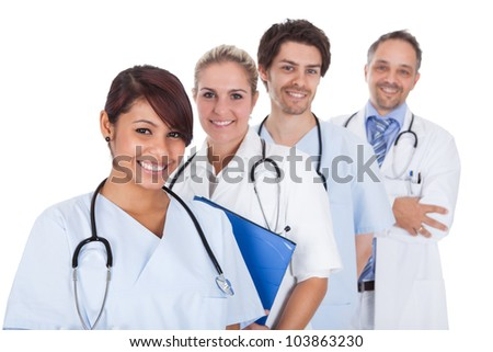 Group of doctors standing together isolated over white background