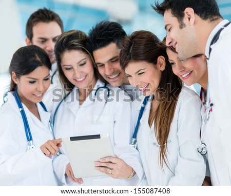 Group of doctors using a tablet computer at the hospital  - stock photo