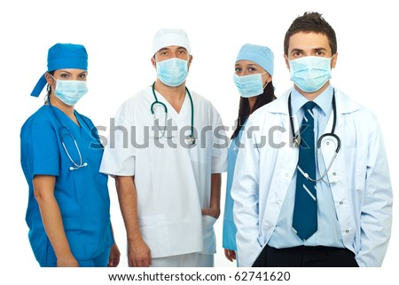 Group of doctors with protective masks isolated on white background - stock photo