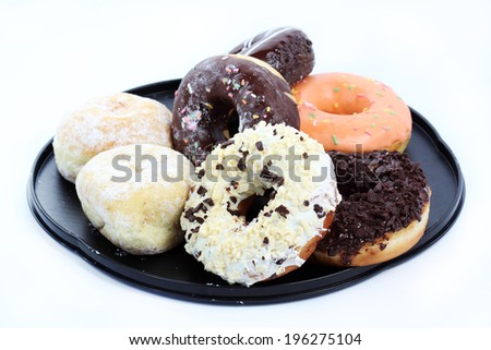 Group of doughnut on the tray on white background - stock photo