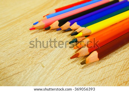Group of drawing pencils on wooden background