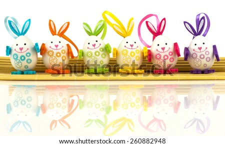 Group of easter eggs on mat, background - stock photo