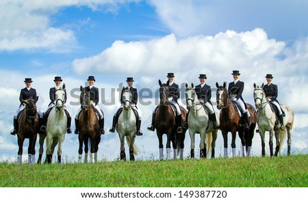 Group of eight women riding horses on the top of the hill. Equestrian sport - dressage. - stock photo