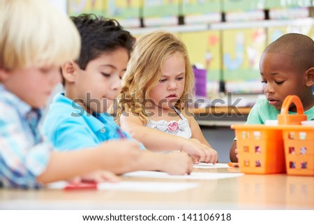 Group Of Elementary Age Children In Art Class - stock photo