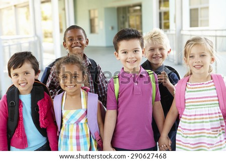 Group Of Elementary Age Schoolchildren Standing Outside