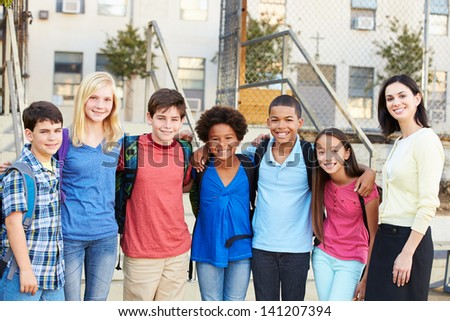 Group of Elementary Pupils Outside Classroom With Teacher - stock photo