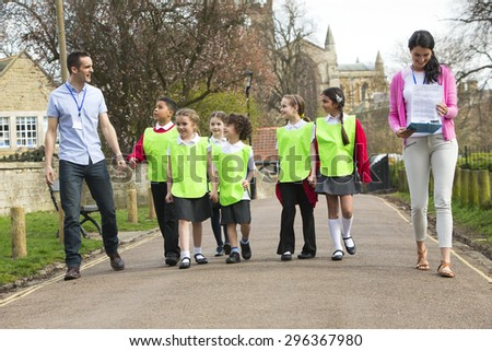Group of elementary school children on class field trip, with their teachers  - stock photo