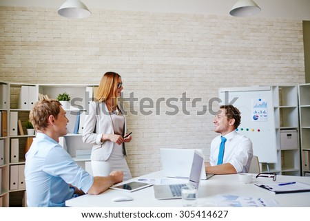 Group of employees discussing ideas of business development