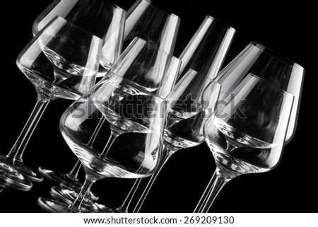 group of empty wine glasses on black - stock photo