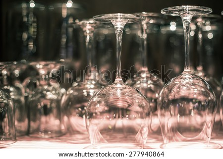 group of empty wine glasses on the table, black and white  - stock photo