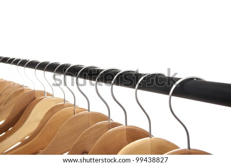 Group of empty wooden coat hangers  row on a white background
