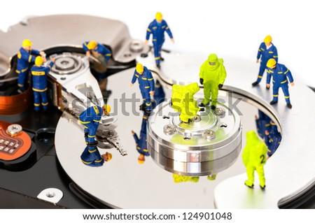Group of engineers maintaining hard drive. Computer repair concept - stock photo