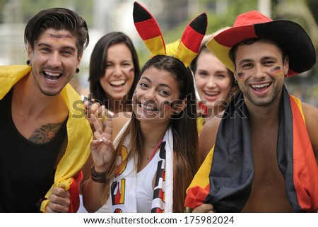 Group of enthusiastic German sport soccer fans celebrating victory. - stock photo