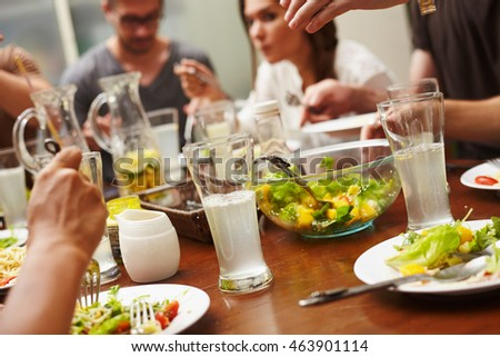 Group of europeian friends enjoing food for one big table