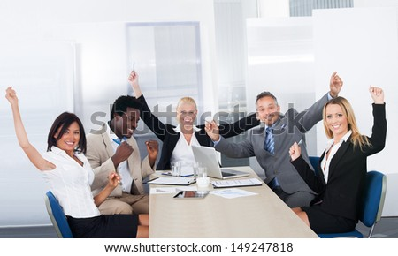 Group Of Excited Multi Ethnic Businesspeople In Office - stock photo