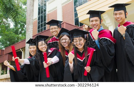 Group of excited university graduates - stock photo