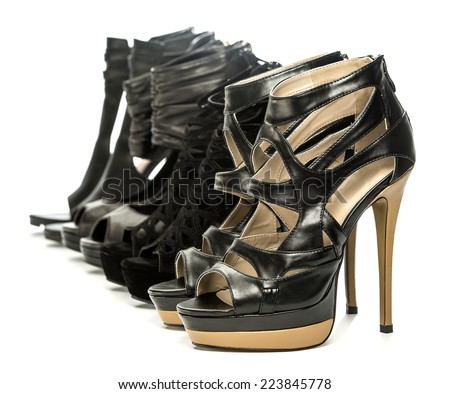 group of fashionable high heels shoes in black;