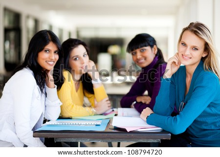 group of female college students sitting by school cafeteria - stock photo