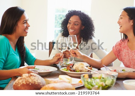 Group Of Female Friends Enjoying Meal At Home - stock photo