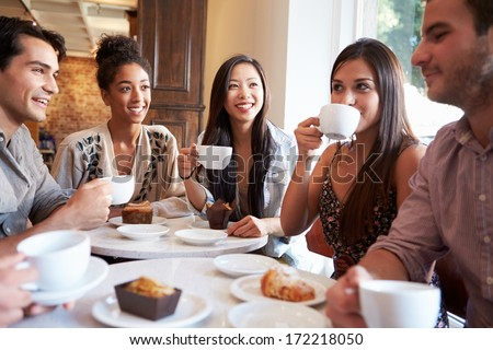 Group Of Female Friends Meeting In Cafe Restaurant - stock photo