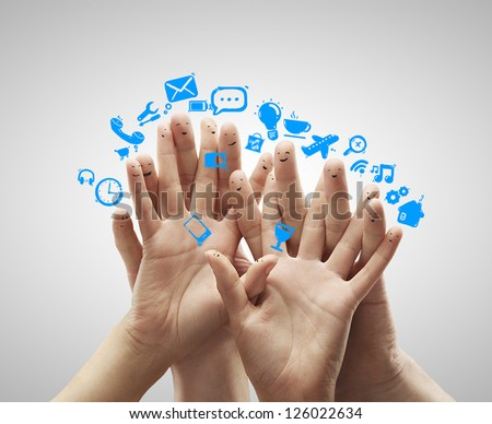 group of finger smileys and social media icons - stock photo