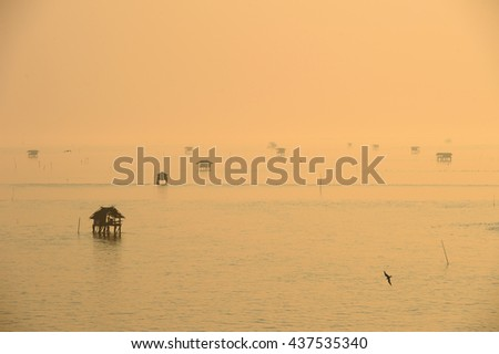 Group of fisherman huts in the sea at Gulf of Thailand - stock photo