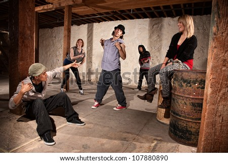Group of five break dancers showing off - stock photo